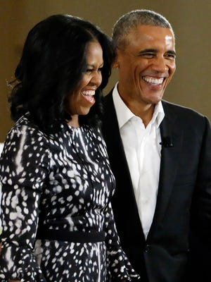 Former President Barack Obama, shown here with wife Michelle Obama, will turn 57 on Saturday. His birthday is now a holiday in his former home state of Illinois.
