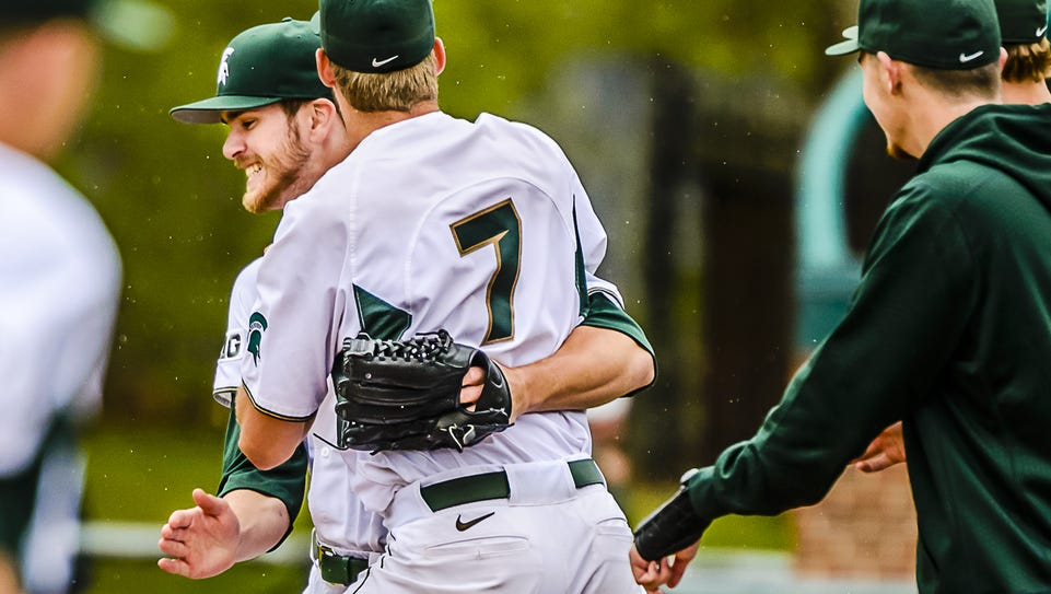 MSU pitcher Ethan Landon (7) hugs fellow MSU pitcher
