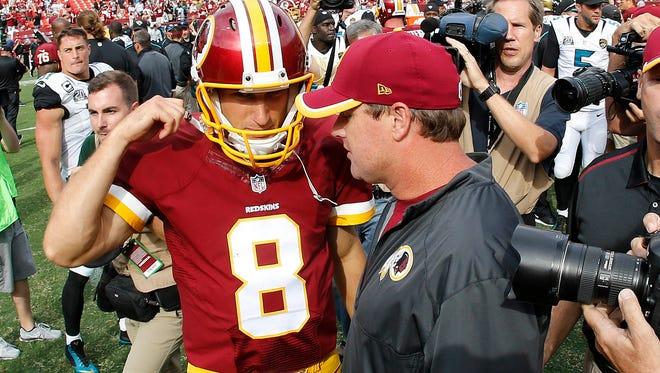 Redskins quarterback Kirk Cousins talks with head coach Jay Gruden after Washington's win Sept. 14 at FedEx Field.