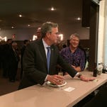 Presidential candidate Jeb Bush orders a white wine ahead of his speech to the Clinton County GOP in Goose Lake on Monday night.