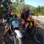 Mark Stockeland, left, and his wife, Lacey Stockeland, right, pose for a picture with their kids while in Haiti. Mark is the executive director of the Haiti Bible Mission.