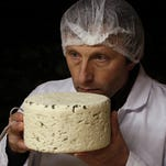 Bernard Roques checks a Roquefort cheese as it matures in a cellar in Roquefort, southwestern France. On Thursday researchers at Purdue University announced findings that show people have a distinct and basic taste for fat, and propose expanding the taste palate to include it along with sweet, salty, bitter, sour and relative newcomer umami.