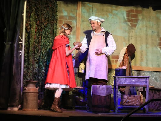 "Autumn Best plays Little Red Riding Hood and BJ Cox plays The Baker in St. George Musical Theater's 2016 production of ""Into the Woods."""