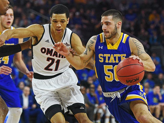 Omaha's Zach Jackson (21) defends SDSU's Michael Orris in last year's Summit League tournament championship game.