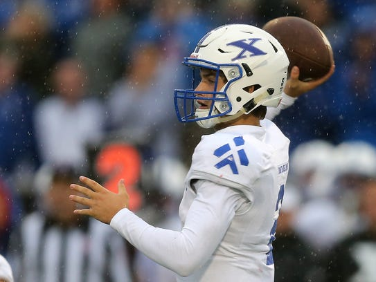 St. Xavier quarterback Chase Wolf (2) throws in the