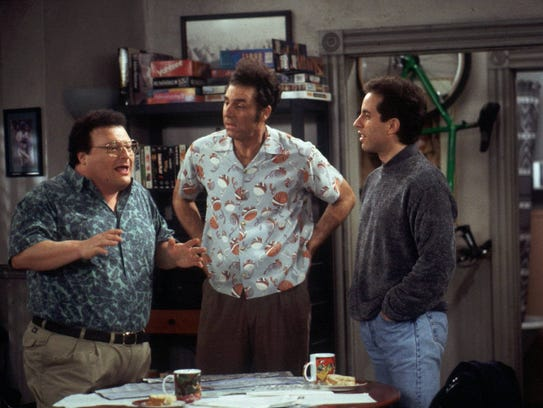 "ADV. FOR WKD. EDS., MAY 8-10--FILE--Newman (Wayne Knight), left,  and Kramer (Michael Richards), center, explain their new idea of bringing a rickshaw business to New York City to Jerry (Jerry Seinfeld) in this scene from a 1998 episode of NBC's hit sitcom ""Seinfeld."" Knight is one of the ""Seinfeld"" supporting players who deserve apprecation as stellar second bananas.(AP Photo/Joey DelValle, NBC)"