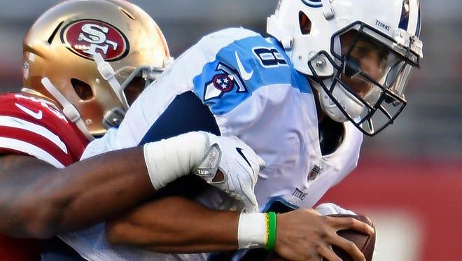 Titans quarterback Marcus Mariota (8) is sacked in the second half Sunday.
