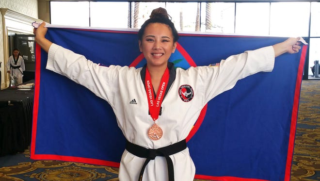 Michelle Caluag shows off her bronze medal and the Guam flag at the 2017 Las Vegas International Taekwondo Open.