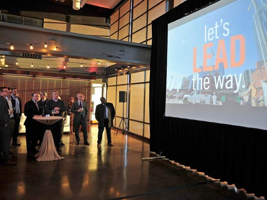 People watch a video of Nashville Area Chamber of Commerce's regional economic development successes during a meeting at The Bridge Building on Thursday.