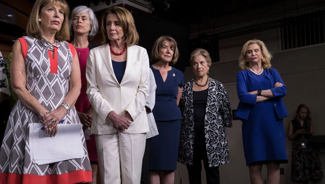 """From left, Rep. Jackie Speier, D-Calif., Rep. Katherine Clark, D-Mass., House Minority Leader Nancy Pelosi, D-Calif., Rep. Susan Davis, D-Calif., Rep. Jan Schakowsky, D-Ill., and Rep. Carolyn Maloney, D-N.Y., stand with fellow House members to speak out against President Donald Trump's tweet about a female cable TV anchor during a news conference called by Leader Pelosi who earlier called it """"so beneath the dignity of the president of the United States to engage in such behavior,"""" at the Capitol in Washington, Thursday, June 29, 2017."""