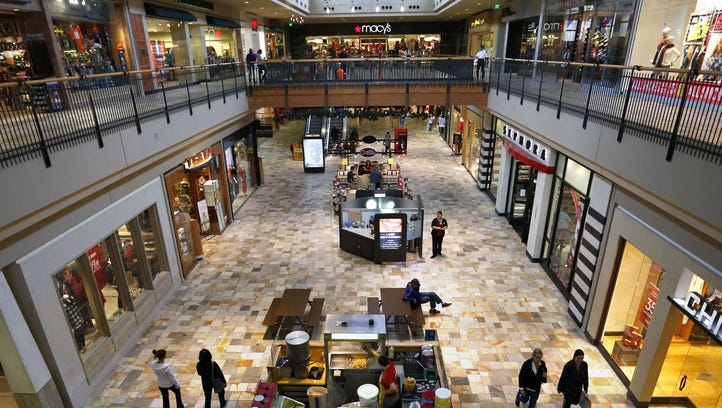 Shoppers look for deals inside the Flatiron Crossing