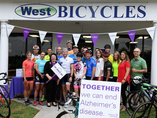 "Riders and workers pose for a photo before leaving a Pedal for Alzheimer's event Thursday, June 21, 2018 from  West Bikes in Farragut. On the Summer Solstice, they are celebrating ""the longest day"" by honoring those who help with Alzheimer's and recognizing how every day can be the longest day."