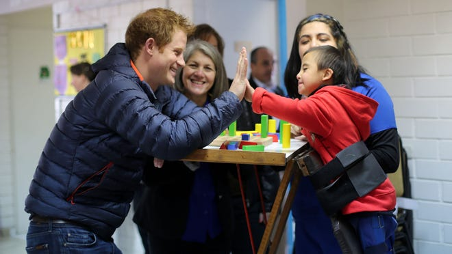 Prince Harry plays with Russel, 4, at a school for children with disabilities in Santiago, Chile, on June 29.