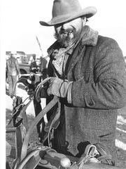 Dr. Larry Cooper of Springtown, Texas, unhitches a wagon harness after the Texas Bicentennial Wagon Train's arrival in Henrietta. This photo is from the Feb. 8, 1976, Times Record News. Cooper, who rode with Hazel Bowen of Antelope, was the winner of a Fort Worth radio contest that entitled him to ride with the wagon train to Wichita Falls