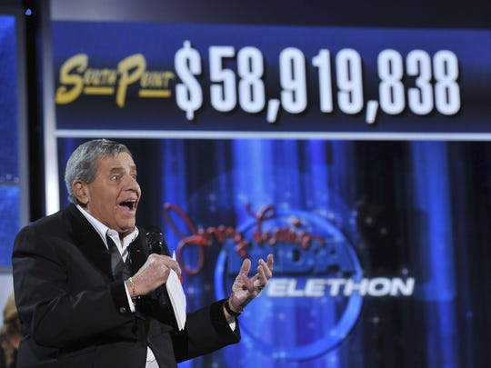 In this file photo, Muscular Dystrophy Association National Chairman Jerry Lewis announces the 2010 Labor Day telethon raised $58.9 million.
