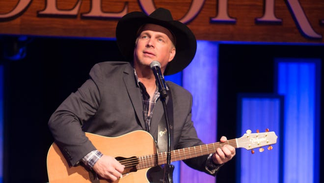 Garth Brooks performs at an event honor country music radio host Bob Kingsley at the Grand Ole Opry House in Nashville, Tenn., on Feb. 17, 2014.