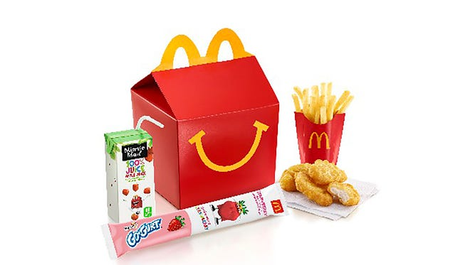 McDonalds Happy Meal with Minute Maid apple juice, Go-Gurt Strawberry yogurt, Chicken McNuggets and snack-size fries.