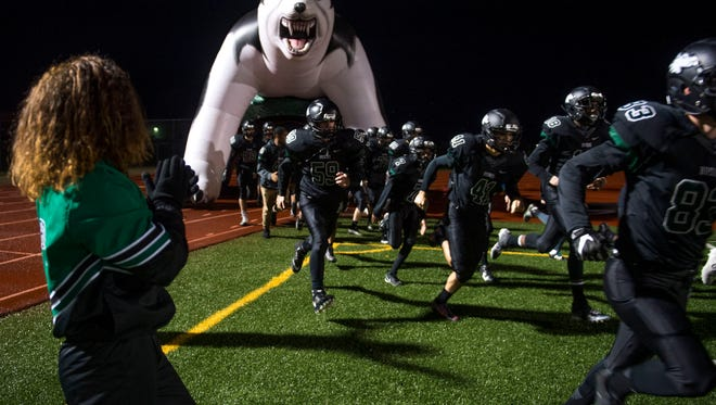 North will actually come out of the Husky tunnel Friday night wearing its road white uniforms.