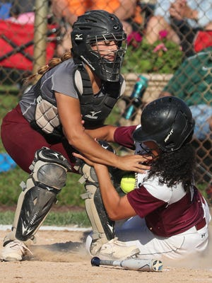Caravel catcher Nicole Marcon puts a tag on Appoquinimink's Andrea Johnson on a fourth inning force at the plate during a DIAA state tournament semifinal.