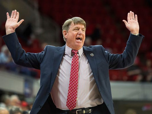 North Carolina State head coach Wes Moore reacts to a call during the first half of a first-round game in the NCAA women's college basketball tournament against Elon in Raleigh, N.C., Friday, March 16, 2018. (AP Photo/Ben McKeown)