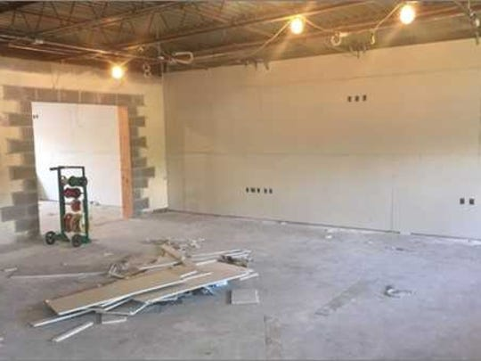 Pictured here is a lower level classroom with a new opening and drywall.