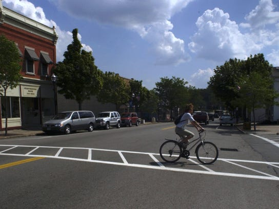 File photo: A bicyclist crosses Route 259 or Main St