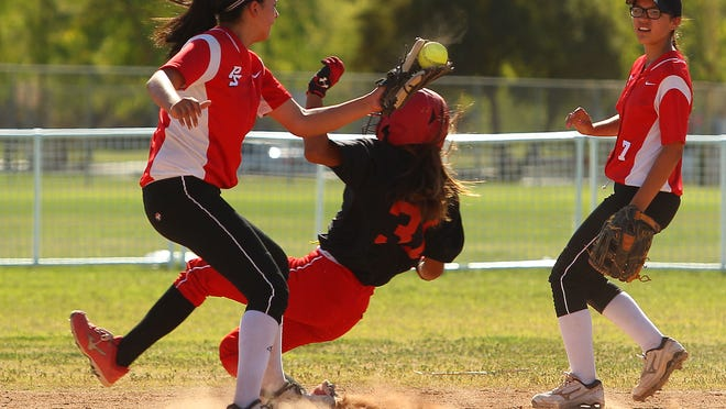 Palm Desert's Jamiana Gateb is safe on second as the throw reached the glove of Palm Springs' Davia Hines on Friday in Palm Springs.