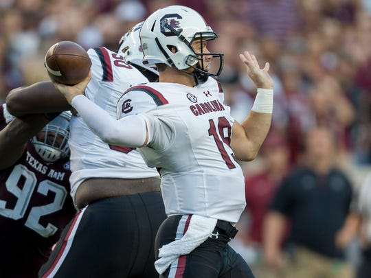 South Carolina quarterback Jake Bentley (19) pass down