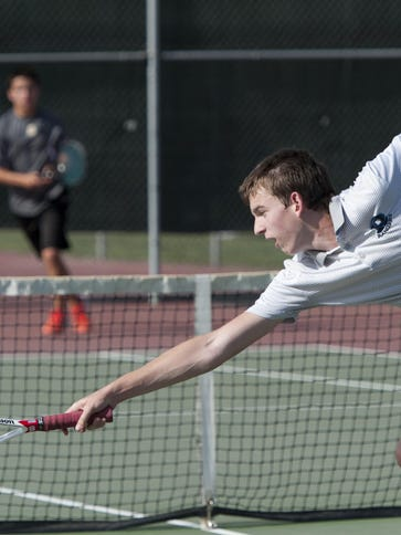 Redwood's Adam Miller, right, reaches for a shot from