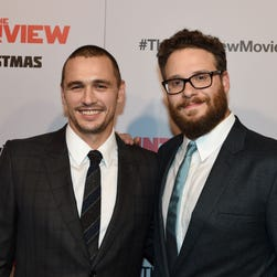 """James Franco (left) and Seth Rogen at the premiere of """"The Interview"""" in Los Angeles, California."""