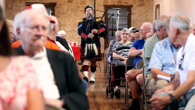 Fort Concho Education Director Chris Morgan plays the bagpipes for attendees during a speaker series event at Fort Concho in September 2015.