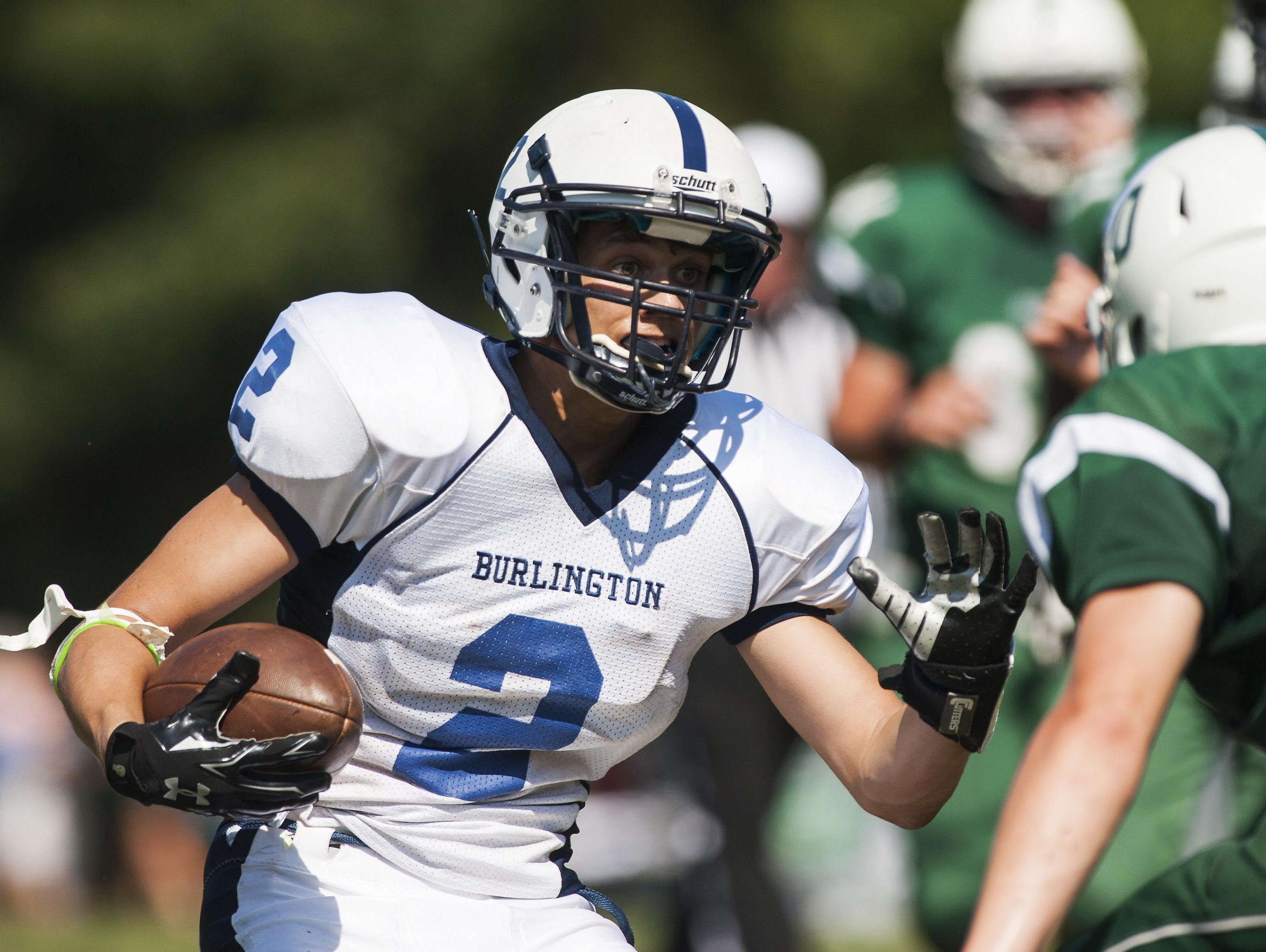 Burlington's Kevin Garrison (2) runs with the ball during the football game between the Burlington Seahorses and the Rice Green Knights at Rice Memorial High School on Sept. 5, 2015.