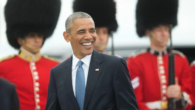 President Obama smiles as he walks across the tarmac upon his arrival on Air Force One at Ottawa Macdonald-Cartier International Airport in Ottawa, Wednesday. Obama traveled to Ottawa for the North America Leaders' Summit with Canadian Prime Minister Justin Trudeau and Mexican President Enrique Pena Neito.