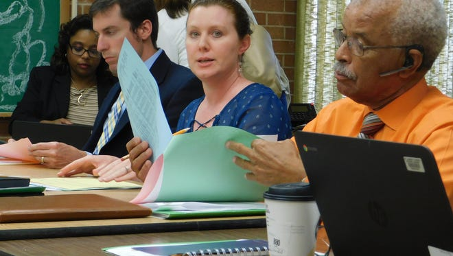 St. Landry school district finance director Tressa Miller explains the annual general fund budget during a recent committee meeting. At her left is assistant superintendent Joseph Cassimere.