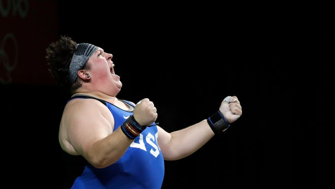 Sarah Elizabeth Robles, of the United States, celebrates after a lift during the women's 75kg weightlifting competition at the 2016 Summer Olympics in Rio de Janeiro, Brazil, Sunday, Aug. 14, 2016.