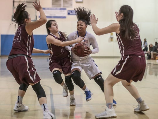 Desert Christian Academy's Aysia Johnson moves the