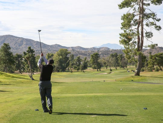 Bob Thompson of Joshua Tree tees off on the fourth hole at Hawk's Landing Golf Course in Yucca Valley.