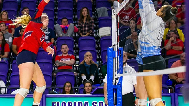 Vanguard outside hitter Alexa Schmidt (left) hammers a shot from the outside as Ponte Vedra's Zeta Washington (14) leaps for the block in the FHSAA Class 5A volleyball final in 2019. The teams meet again in Saturday's state semifinal.