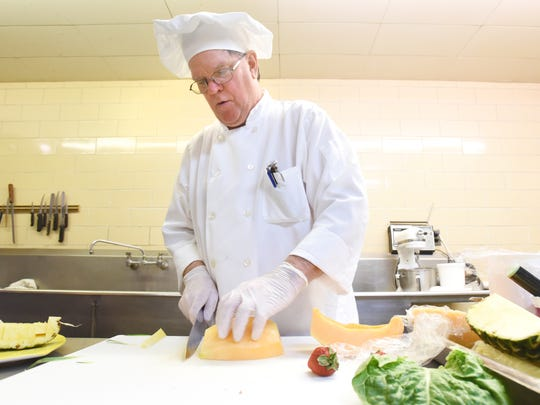 Executive Chef Russell Benedict prepares a chunky chicken salad at Bryan Place recently.