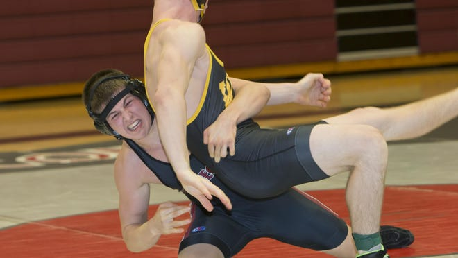 Winneconne's Rutger Braun takes down Waupun's Carter Veleke wrestling in the 160-pound weight class on Thursday.