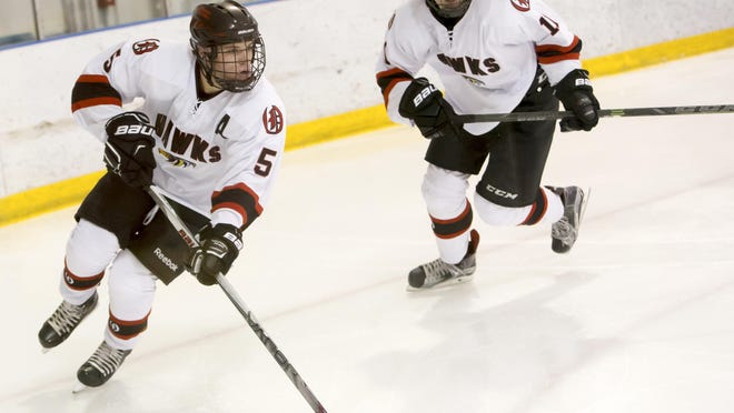 Jack Sitter (5) of the Ice Hawks skates the puck up ice during Tuesday's game against St. Mary's Springs.
