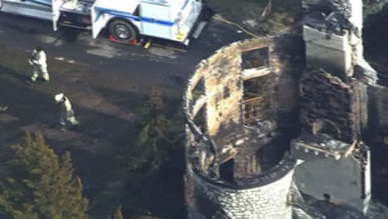 Crews search the debris of the Annapolis mansion fire