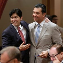 State Senators Kevin de Leon, D-Los Angeles, left, and Alex Padilla, D-Los Angeles, celebrate after lawmakers approved Padilla's bill to ban single-use plastic bags at the Capitol in Sacramento, Calif., Friday, Aug. 29, 2014. By a 22-15 vote, the Senate approved SB270  that makes California the first state to impose a statewide ban on single-use plastic bags. The bill now goes to  Gov. Jerry Brown.  De Leon had previously opposed the bill, but gave his support after protections were added for plastic bag manufacturers.