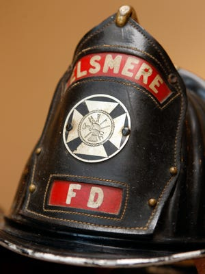 "KYXXHEROESOFFIRE KY JULY 24, 2008 Detail photo of an Elsmere Fire Department  captain's helmet from the 1950's or 1960's which is among the items on display in the  ""Heroes of Fire/EMS"" exhibit   at the Behringer-Crawford Museum, Devou Park, Covington.  The exhibit, which runs from 7/26/08-10/26/08, features historical items including clothing, helmets, breathing apparatus and hose nozzles.  The exhibit coincides with  the Kentucky Firefighter's Association's 2008 Annual Conference in August at the Drawbridge Inn, Fort Mitchell.  Siegrist's father, Richard Siegrist, is a retired Covington firefighter.  The Enquirer/Patrick Reddy"