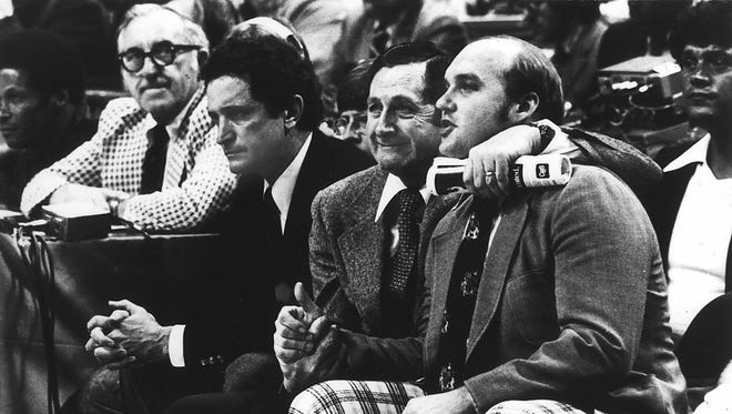 As Al McGuire (left) cried, Hank Raymonds and Rick Majerus celebrated in the final seconds of Marquette's victory over North Carolina in the 1977 title game.