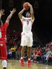 Rutgers Corey Sanders puts up a second half jumper in front of Howard's Keon Hill, Sunday, November 15, 2015, at the Louis Brown Athletic Center in Piscataway.