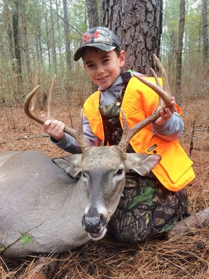 Hunters like Aidan Dilley, 9, of Forest, may experience prime conditions for the opening weekend of gun season for deer.