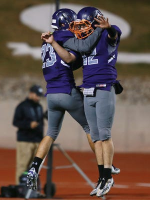 Eastlake receiver Isaiah Holguin, left, and quarterback Keith Tarango-Lopez celebrated after they teamed up for a long second quarter touchdown during last week's playoff game. .