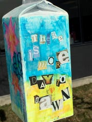 """This is among the birdhouses students at West Bloomfield High School made to bring hope and good thoughts to the courtyard following a spate of suicides. Its inspirational message is """"There is more day to dawn."""""""
