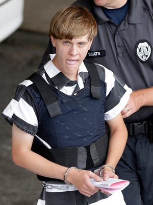 FILE -In this Thursday, June 18, 2015 file photo, convicted shooter Dylann Roof is escorted from the Cleveland County Courthouse in Shelby, N.C. Roof was convicted of killing nine congregants at Emanuel AME Church, Wednesday, June 17, 2015 in Charleston, S.C. A federal jury will consider whether Roof should be sentenced to death or life in prison for killing nine black church members in the racially motivated attack. (AP Photo/Chuck Burton, File)